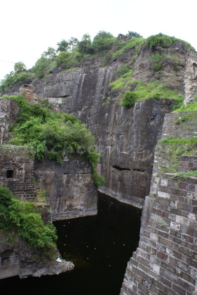 The rock cut walls and the moat below