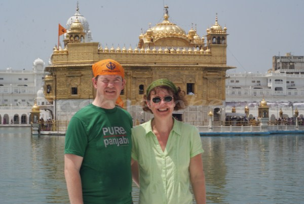 Jane and Kev at the Golden Temple, with Kev wishing he hadn't left his sunglasses in Delhi