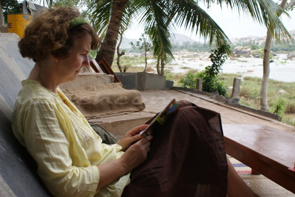 Mum reading a book in front of the lovely view